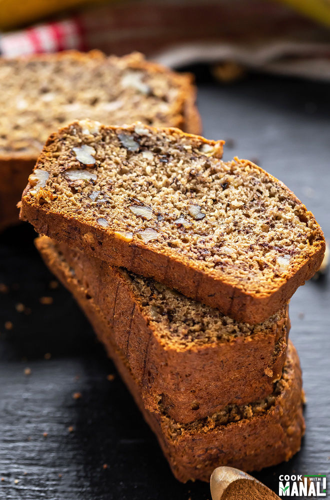 stack of banana bread with the top most slice placed in a way to show the texture of the bread