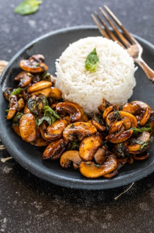 balsamic mushrooms placed in a round plate along with white rice