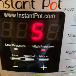 instant pot displaying a timer of 5 minutes at high pressure