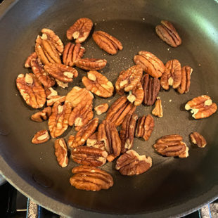 pecans placed in a small pan