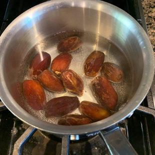 dates in a pot full of water