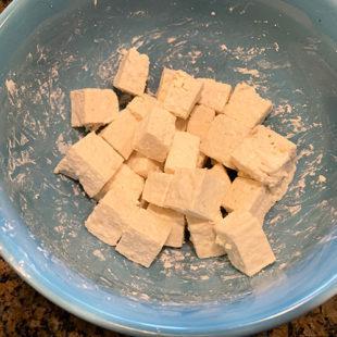cubes of tofu coated in cornstarch