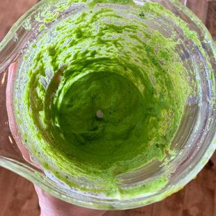 green cplor paste in a blender