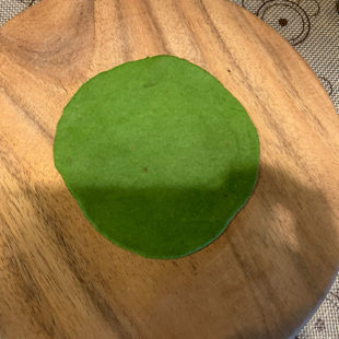 green color dough rolled into a circle