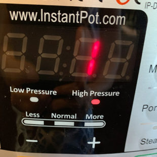 instant pot display showing 1 minute