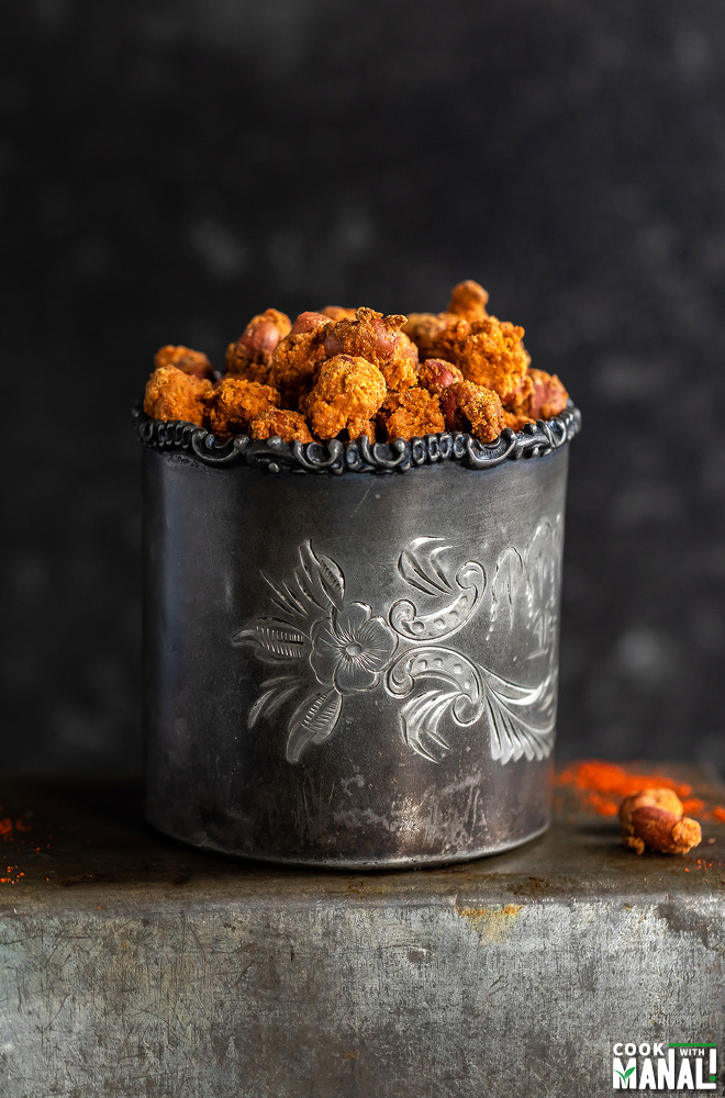 masala peanuts placed in a silver antique glass