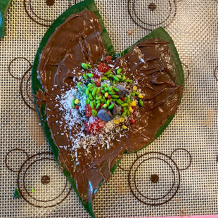 paan leaf topped with tutti frutti, coconut powder