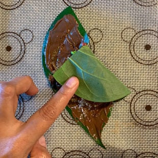 cut side of a paan leaf being folded
