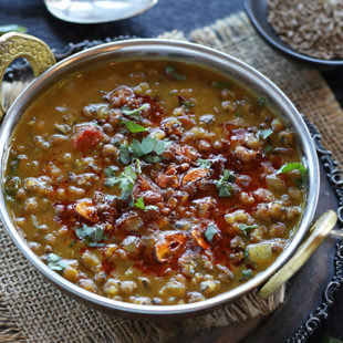 lentils topped with spices and cilantro
