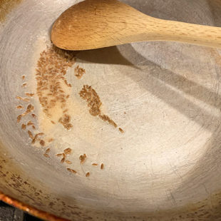 cumin seeds in a kadai