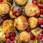 overhead shot of roasted brussel sprouts with pomegranate