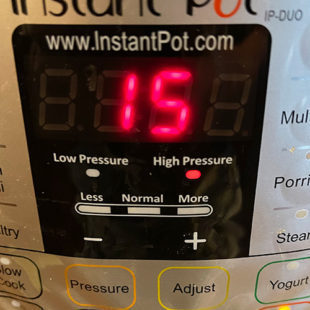 instant pot screen displaying 15