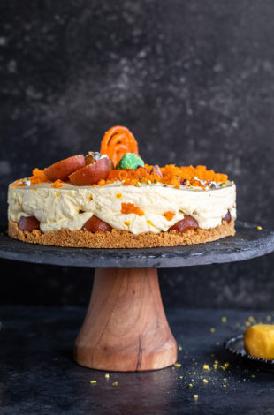 mithai cheesecake on a wooden cake platter