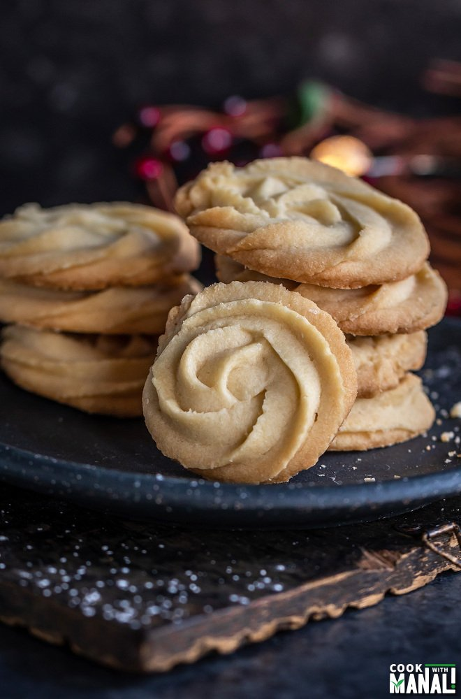 stack of cookies with one rosette shaped cookie placed in the front to show the design