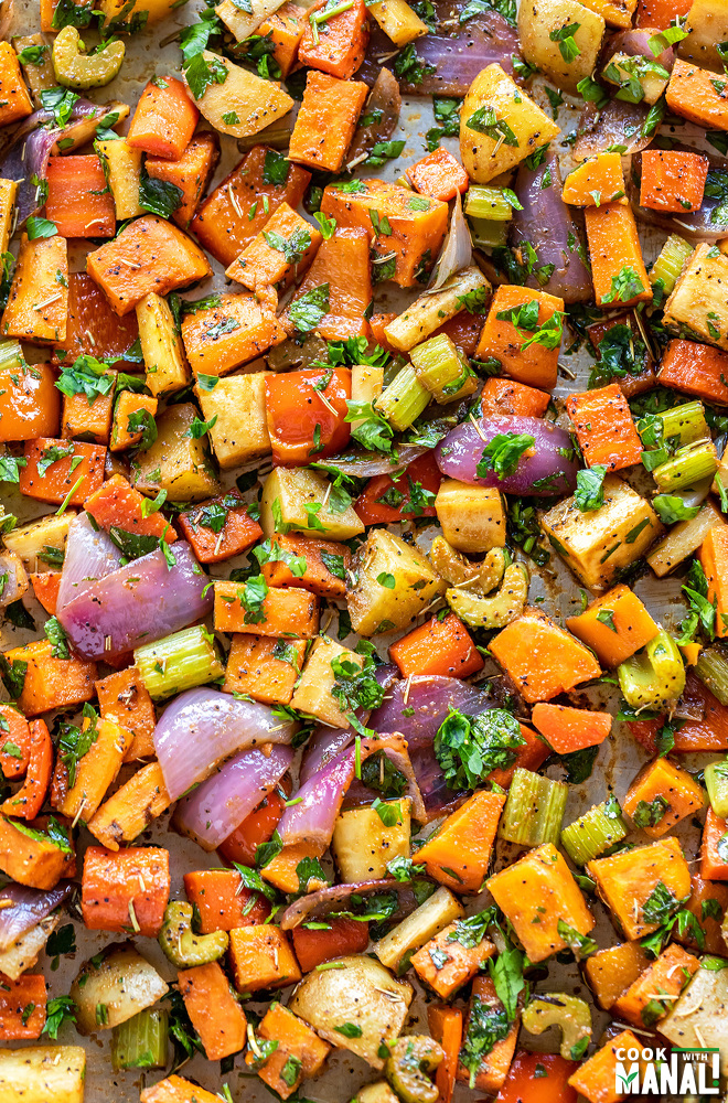 assorted roasted veggies on a baking tray