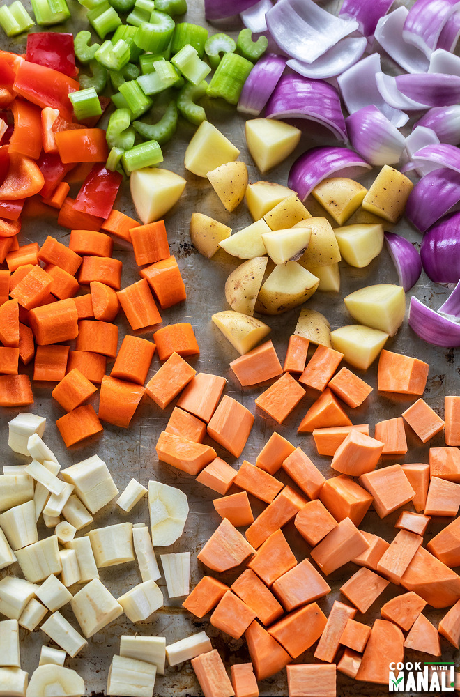 assorted diced vegetables on a baking tray