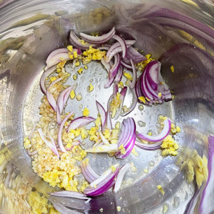 chopped ginger, garlic and sliced onion in pot