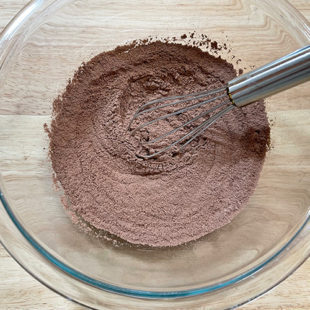 bowl with sifted flour, cocoa powder