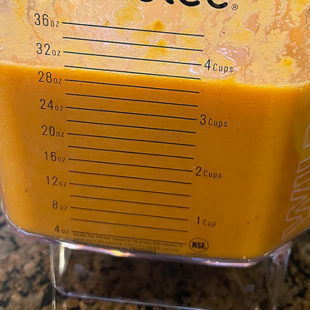 blended tomato soup in a blender