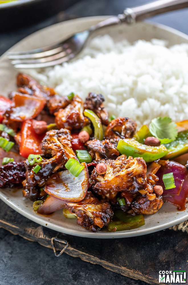kung pao cauliflower served with white rice on a plate