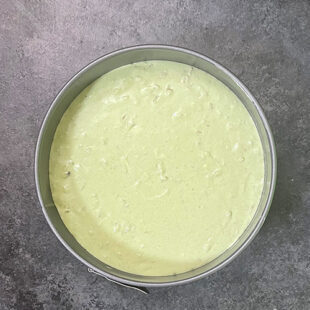 green color batter in a cake pan