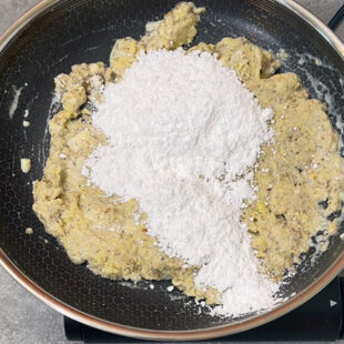 powdered sugar being added to a dough