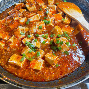 tofu with green onions and chili sauce in a pan