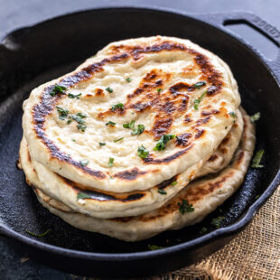 stack of naan on a iron skillet