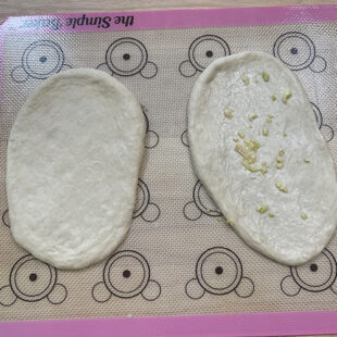 rolled naans with 1 sprinkled with garlic