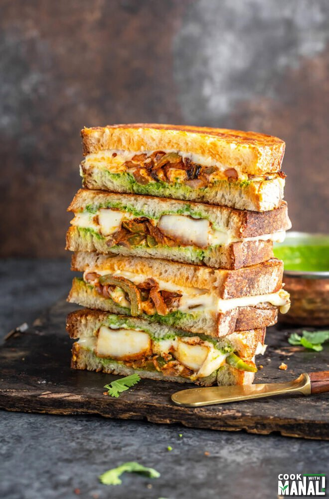 stack of paneer sandwiches cut into half to reveal the inside