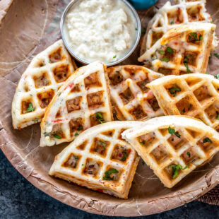 savory waffles served with coconut chutney and glass of chai