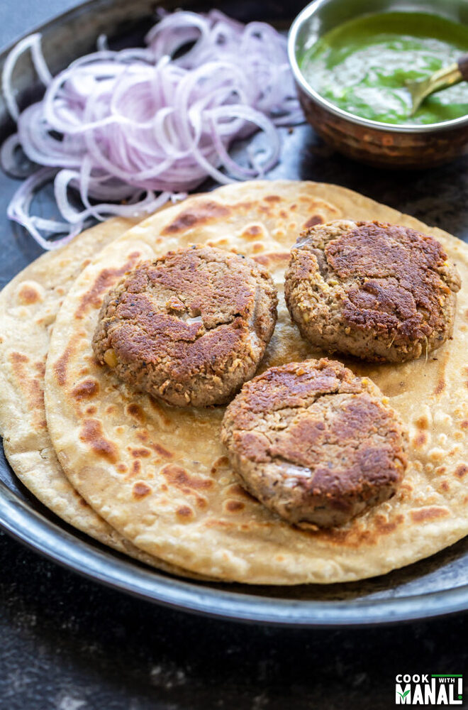 3 kebabs placed on paratha