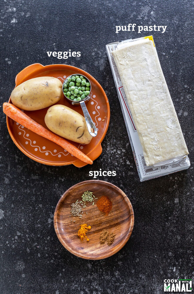 puff pastry sheet, vegetables and spices arranged on a plate