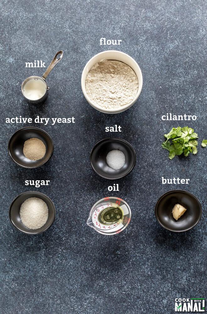 bowls with flour, salt, sugar, yeast arranged on a board