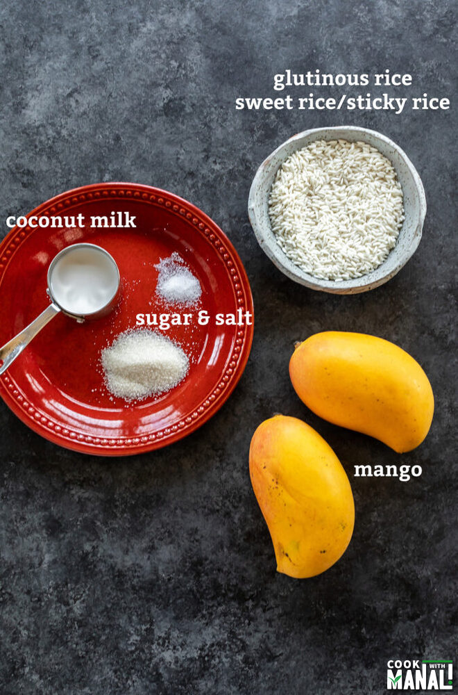 bowl of raw rice, 2 mangoes and a plate with some sugar, salt and coconut milk arranged on a plate