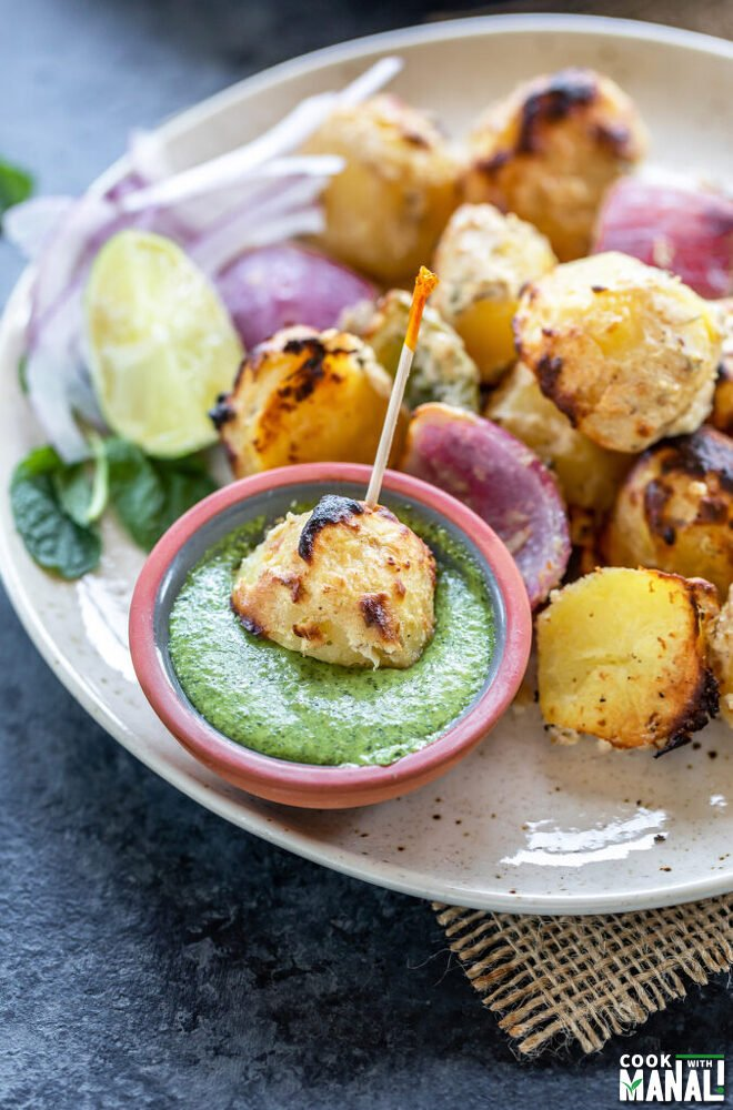 grilled baby potato dipped in a small bowl of green chutney