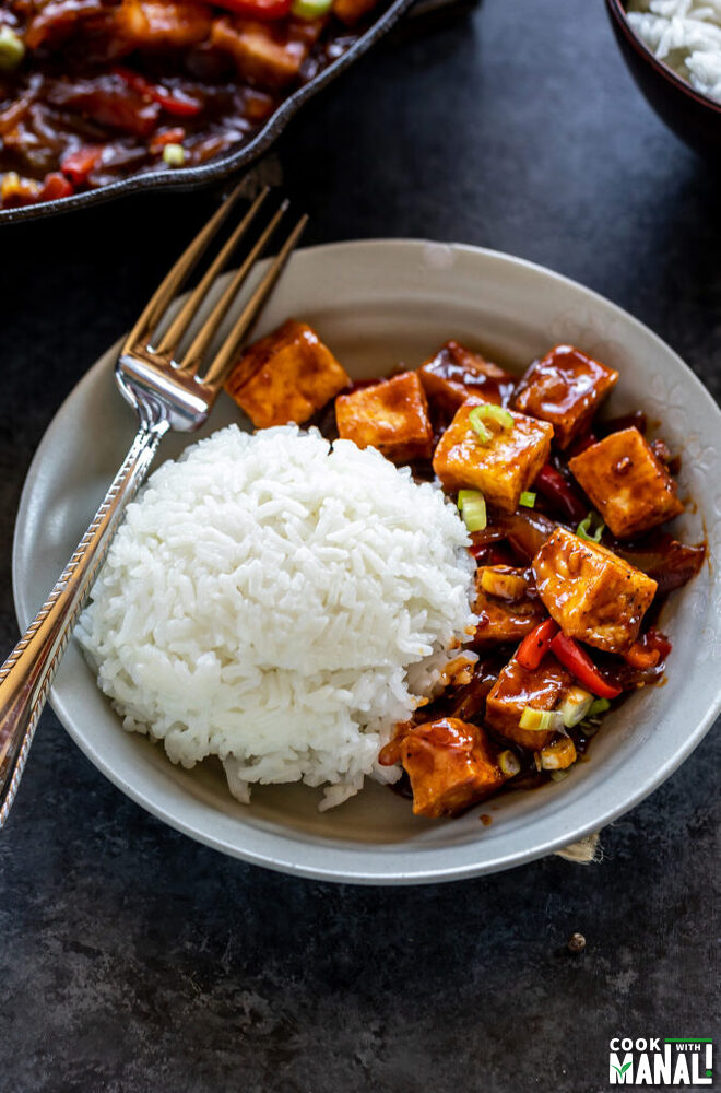 tofu served with white rice in a bowl