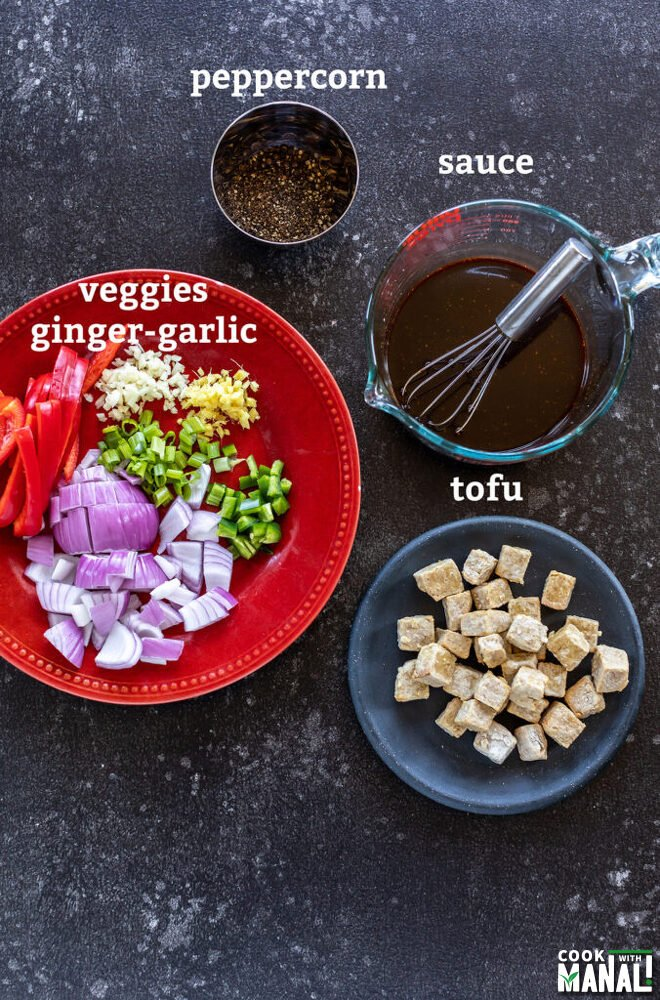 plate with tofu, another with veggies and bowl with peppercorns arranged together