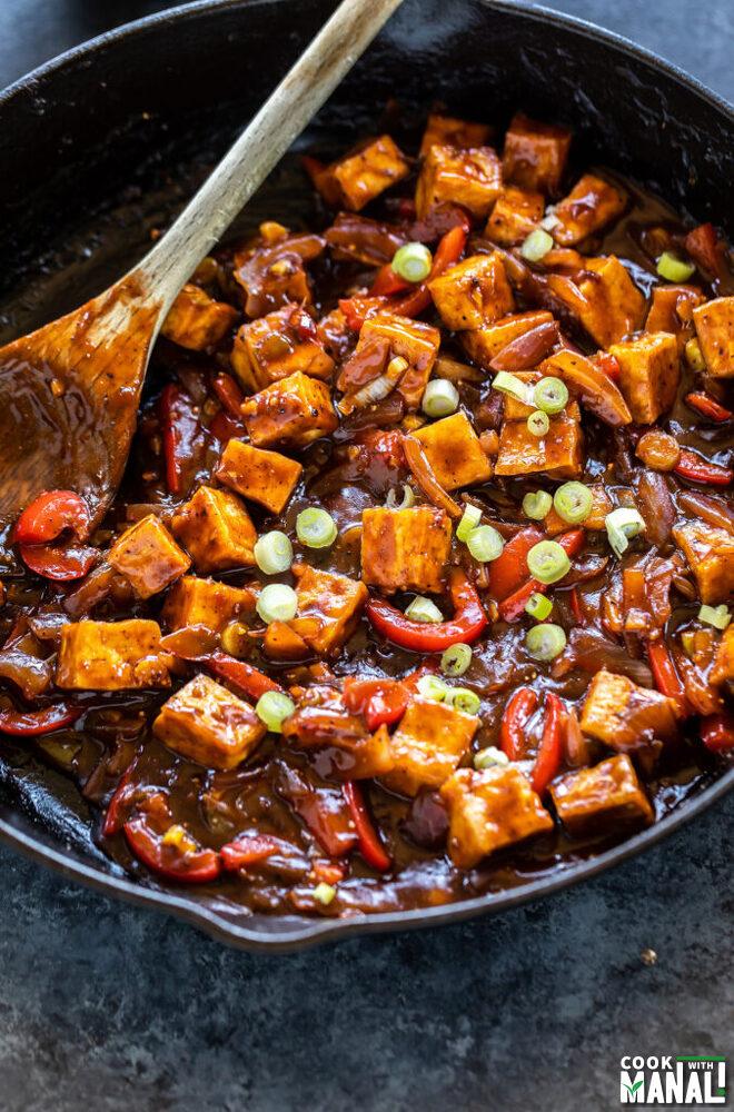tofu and veggies on a cast iron skillet