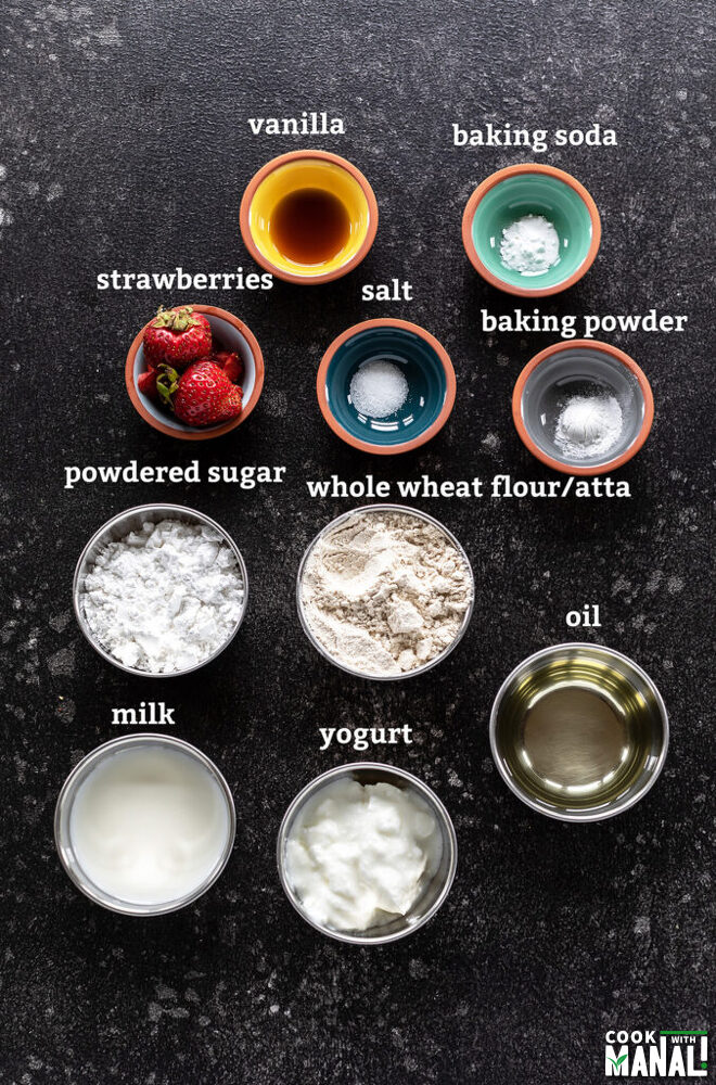 ingredients for eggless strawberry muffins arranged on a board