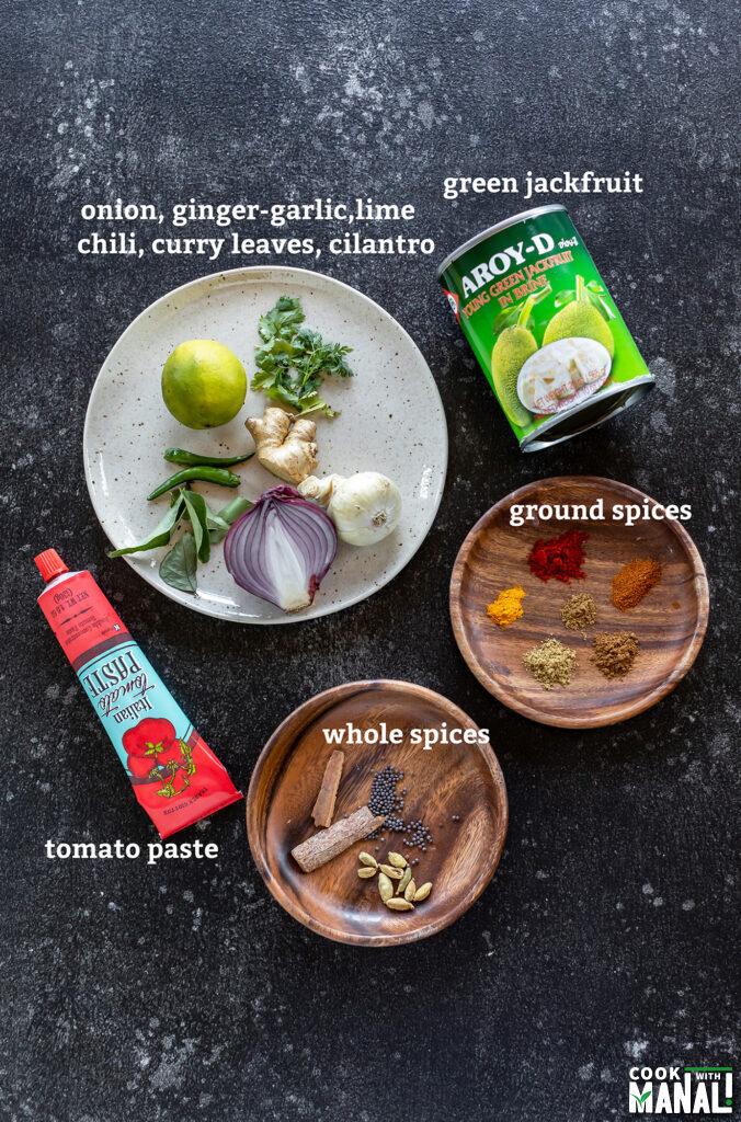 ingredients for making masala jackfruit arranged on a board
