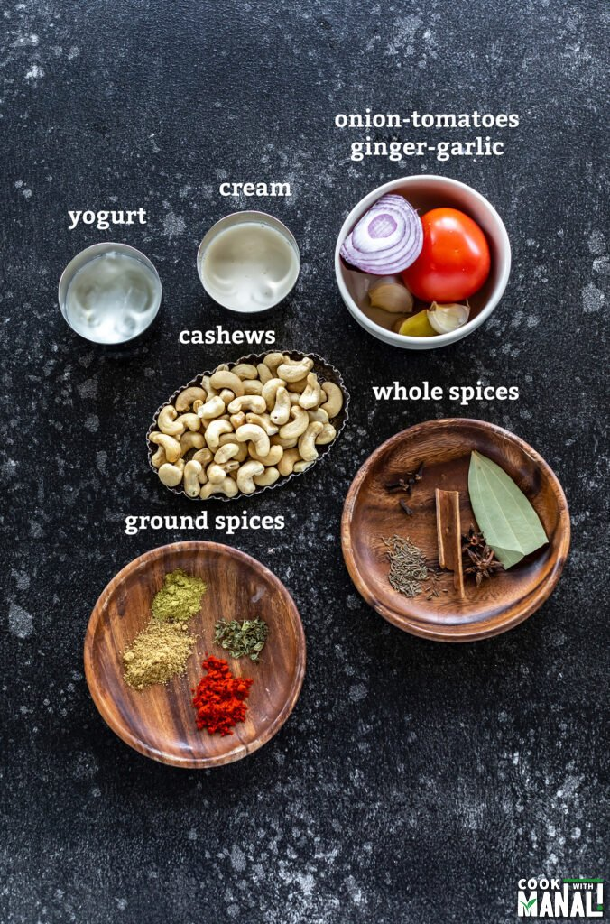 ingredients for making cashew curry arranged on a board