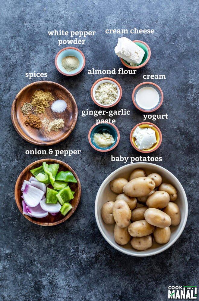 ingredients to make aloo tikka arranged on a board