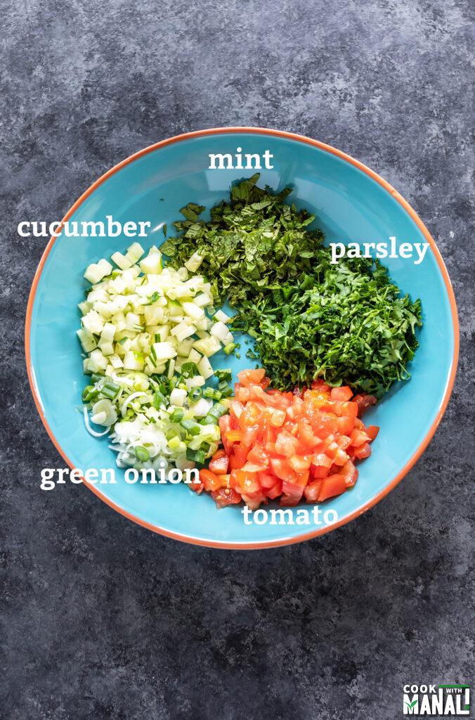 ingredients for lentil tabbouleh salad arranged in a bowl