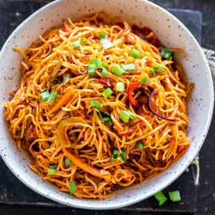 bowl of vegetarian noodles garnished with green onion
