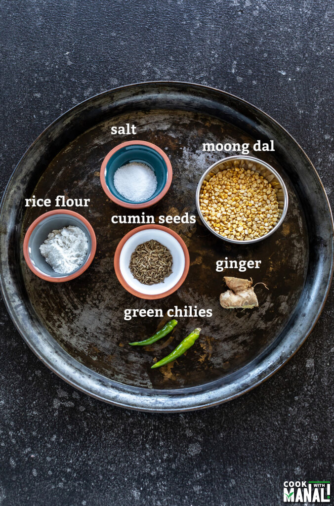 ingredients for moong dal dosa arranged on a board