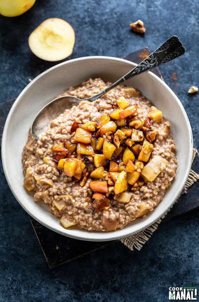oatmeal topped with caramelized apples served in a bowl