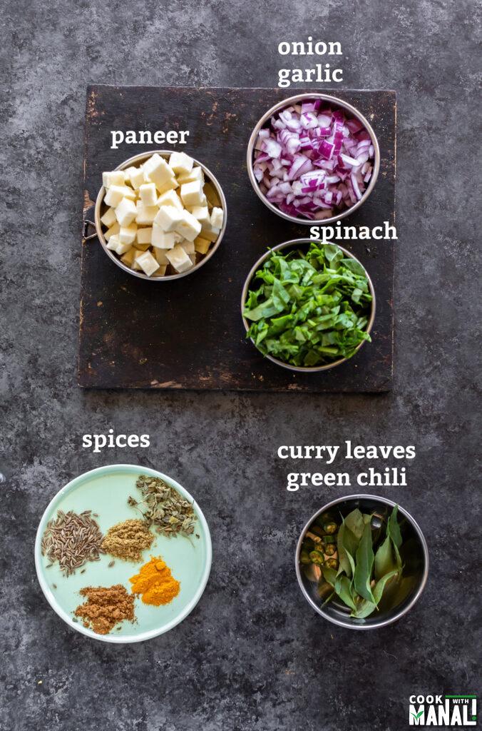 ingredients for palak paneer stir fry arranged on a board