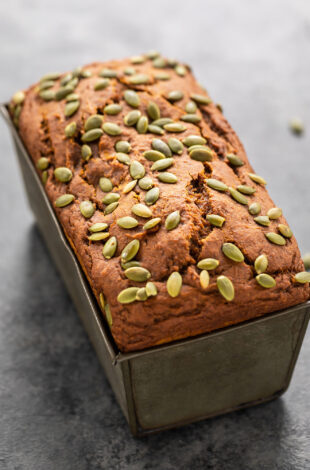 load of pumpkin bread topped with pumpkin seeds