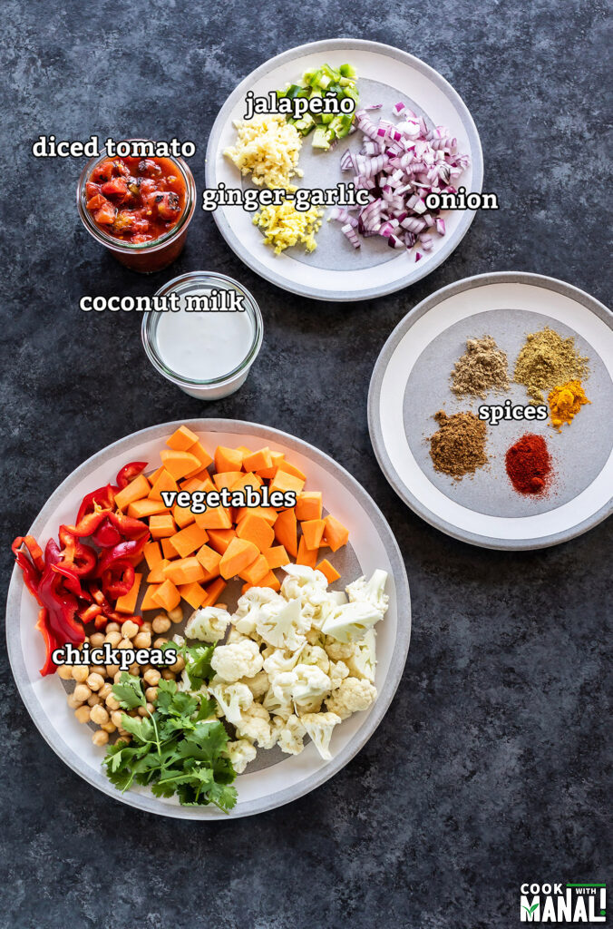 ingredients for vegetable chickpea coconut curry arranged on a board